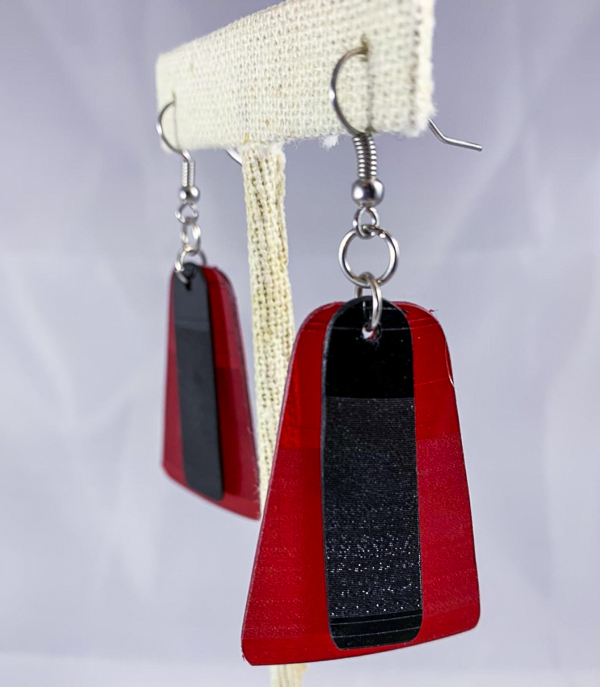 Close-up photo of two red and black repurposed vinyl earrings.