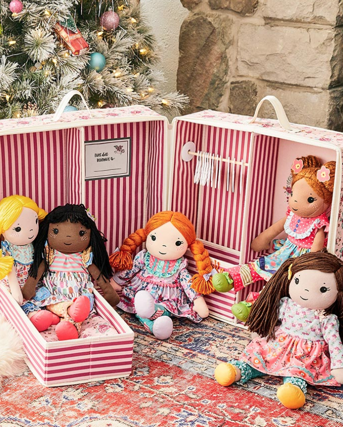 Photo of Matilda Jane dolls arranged in front of a Christmas tree.